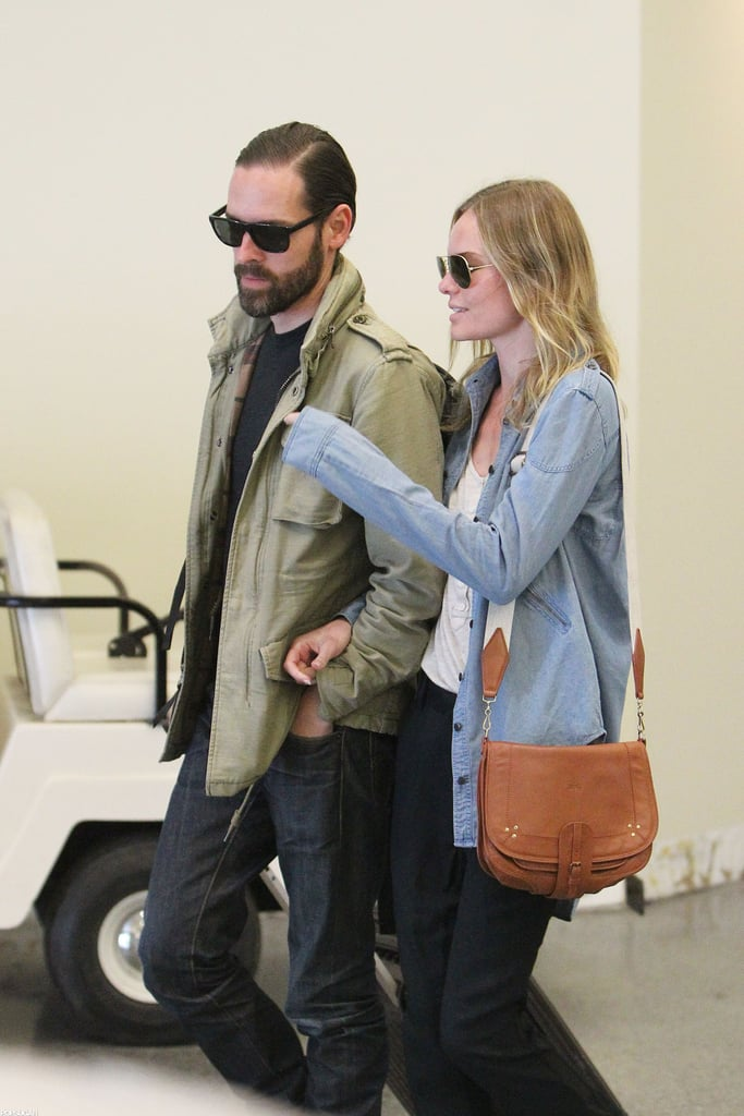 Kate Bosworth and Michael Polish chatted as they made their way through the airport.