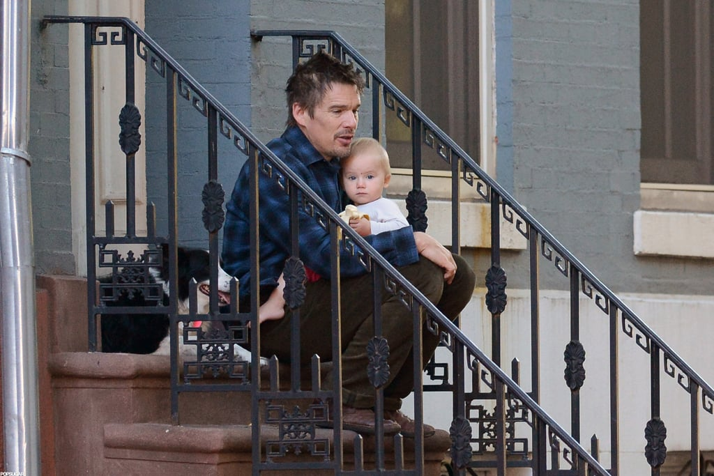 Ethan Hawke sat outside with his youngest child in NYC.