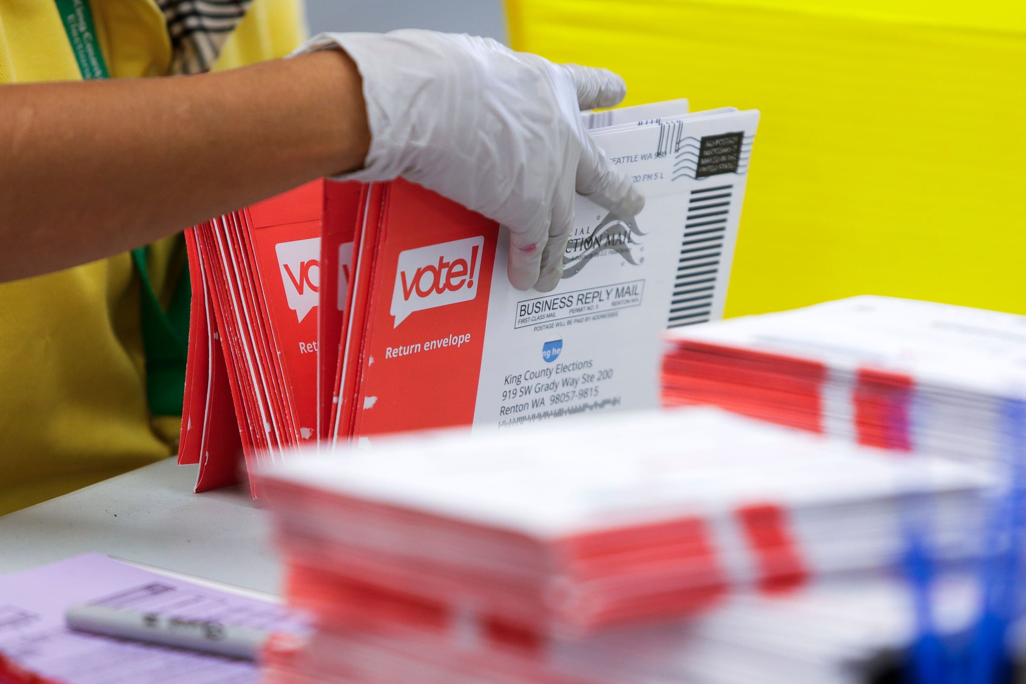 An election worker opens envelopes containing vote-by-mail ballots for the August 4 Washington state primary at King County Elections in Renton, Washington on August 3, 2020. (Photo by Jason Redmond / AFP) (Photo by JASON REDMOND/AFP via Getty Images)
