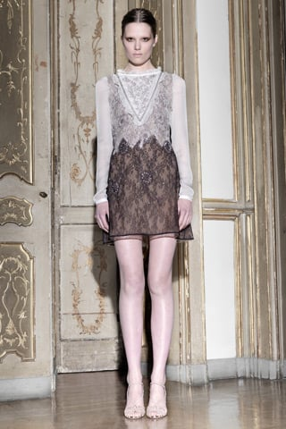 """>> Like at Lanvin, glamorous daywear was the hot topic du jour for Maria Grazia Chiuri and Pier Paolo Piccioli at Valentino. Described as """"techno couture,"""" the designers created ruffled and embellished dresses — made with stretch wool for daytime comfort — along with spunkier leather and lace numbers for Pre-Fall 2011. """"Our goal is to deliver wearable pieces which women can truly enjoy and can mix and match accordingly to their attitude,"""" said Chiuri. Piccioli added: """"We want to transmit the feeling of an effortless elegance."""""""