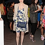 In addition to her sweet printed combo, she also showed off a blue Coach Legacy perforated Swingpack at the party.