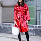 A high-shine red overcoat will make even the most boring look stand out in a crowd.