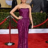 Sarah Hyland popped against the red carpet in a purple strapless lace gown.