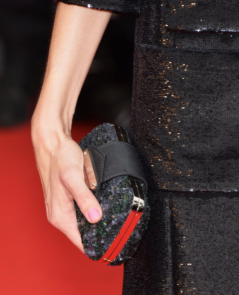 Sofia Coppola carried a black-and-silver clutch.