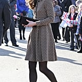 Kate Middleton paired brown boots with an Orla Kiely dress.