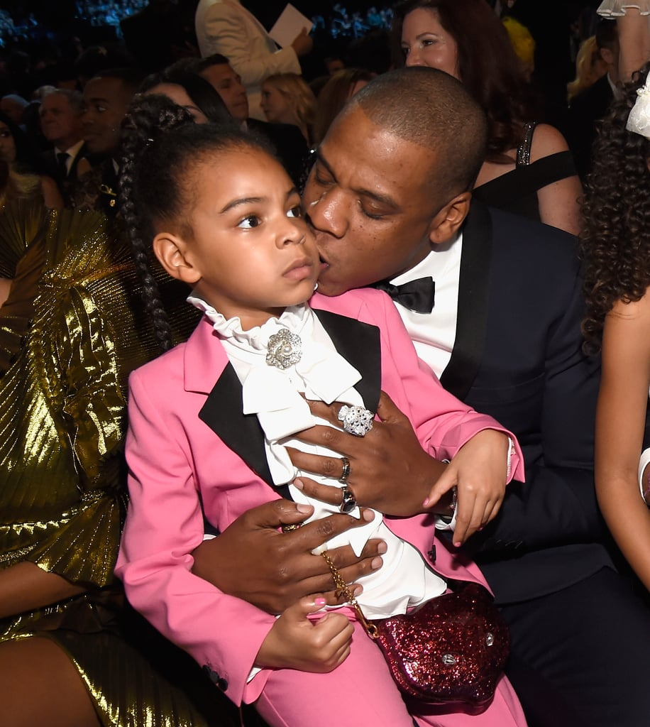 We thought we were ready for Blue Ivy's appearance at the Grammys, but we were wrong. Beyoncé and Jay Z's adorable 5-year-old daughter (who's soon to be a big sister!) attended the show dressed as a miniature version of late singer and fashion icon Prince, and the level of cuteness sent us into brief cardiac arrest. Blue sat on her dad's lap in the audience, just like she did at the 2014 VMAs. Although her pint-size suit wasn't Prince's signature purple colour, the white ruffled shirt and pendant were a perfect way to honour him. Not exactly a surprise after seeing how she slayed her Michael Jackson costume a few years ago!          Related:                                                                                                           Blue Ivy Wanted Absolutely Nothing to Do With the VMAs, and the Internet Was Here For It