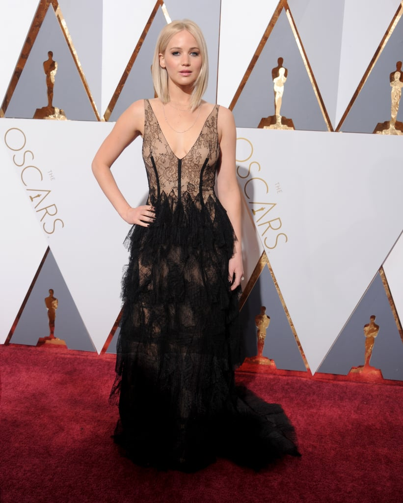 Jennifer's 2016 Oscars dress was made of lace tiers and extended into a full train by Dior Couture. Her outfit was complete with Chopard jewels and Manolo Blahnik shoes.