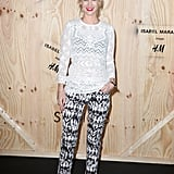 January Jones worked an Isabel Marant for H&M ensemble, including flashy printed pants and a sheer white blouse, at the collection's photocall in Paris.