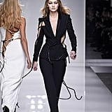 Wearing a Swarovski rope-lined cutout Versace Couture suit for the fashion house's Spring '16 Couture show.