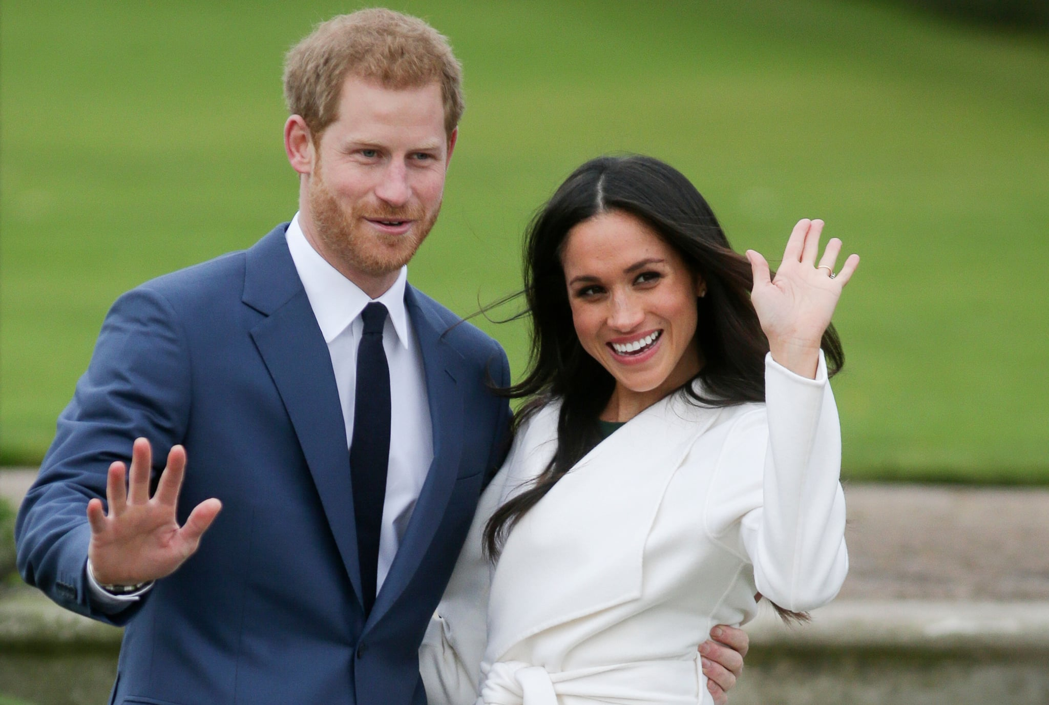 Britain's Prince Harry and his fiancée US actress Meghan Markle pose for a photograph in the Sunken Garden at Kensington Palace in west London on November 27, 2017, following the announcement of their engagement.Britain's Prince Harry will marry his US actress girlfriend Meghan Markle early next year after the couple became engaged earlier this month, Clarence House announced on Monday. / AFP PHOTO / Daniel LEAL-OLIVAS        (Photo credit should read DANIEL LEAL-OLIVAS/AFP/Getty Images)