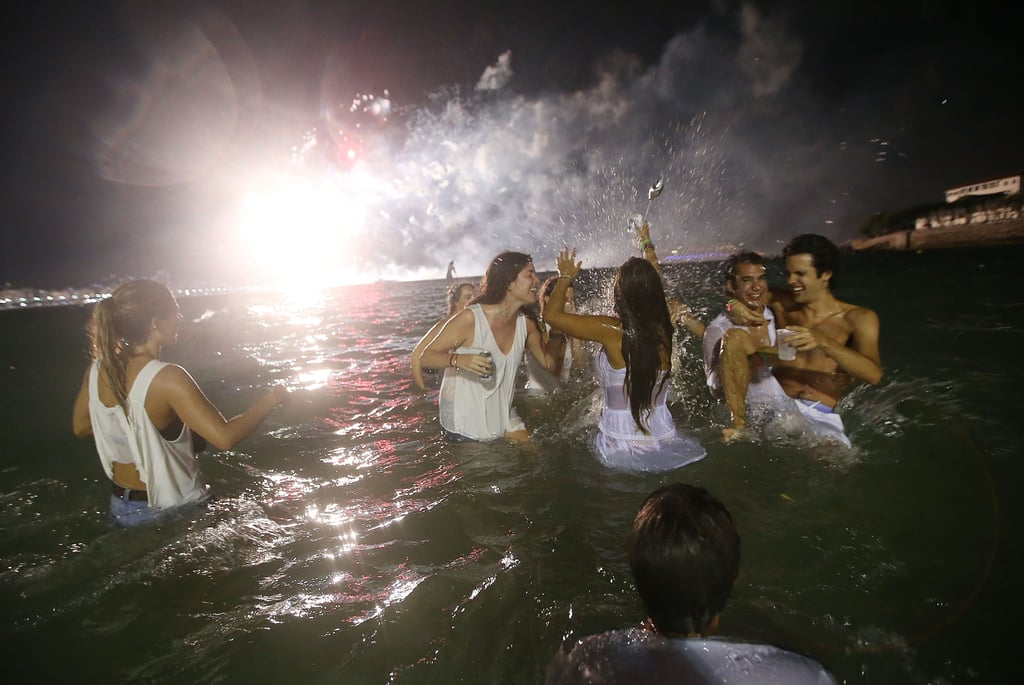 A group of friends celebrated the new year in the water as the fireworks went off.