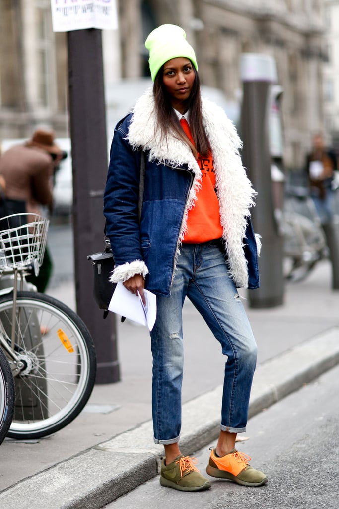 Sporty-chic in a shearling-lined denim jacket, sweatshirt, and the comfiest Fashion Week footwear: Nikes.