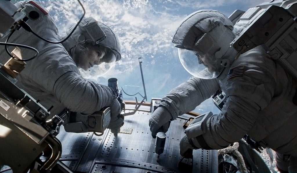 Gravity As far as we know, Sandra Bullock and George Clooney are the only actors in Gravity, Alfonso Cuarón's thriller about two astronauts who get stranded in space. That's perfectly OK with me, because I think the strength of these actors, plus the incredible visuals we've already seen in the trailer, will make for a memorable movie.