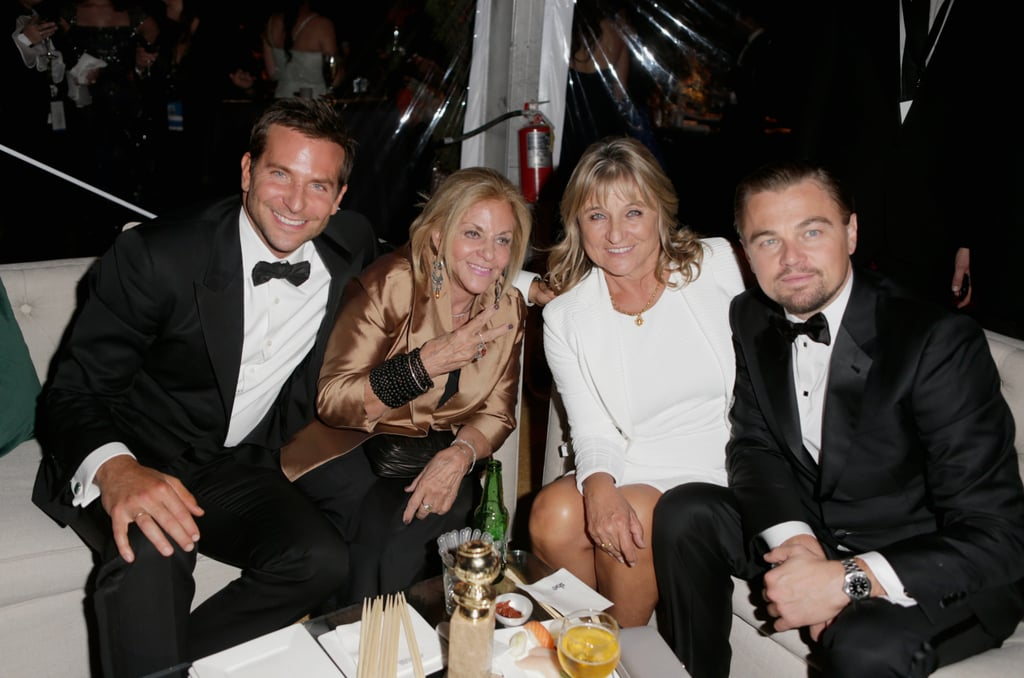 Stars flocked to The Weinstein Company's bash at the Beverly Hilton in LA on Sunday night after wrapping up the Golden Globes. Nominee Liev Schreiber brought his wife Naomi Watts to the bash, while Leonardo DiCaprio held onto his award with his mom by his side and chatted up Bradley Cooper and his mother. Taylor Swift stepped into a shorter dress to buddy up with a bunch of girlfriends, and winner Robin Wright showed off her gold alongside fiancé Ben Foster. Keep scrolling for a look inside the Weinstein party.