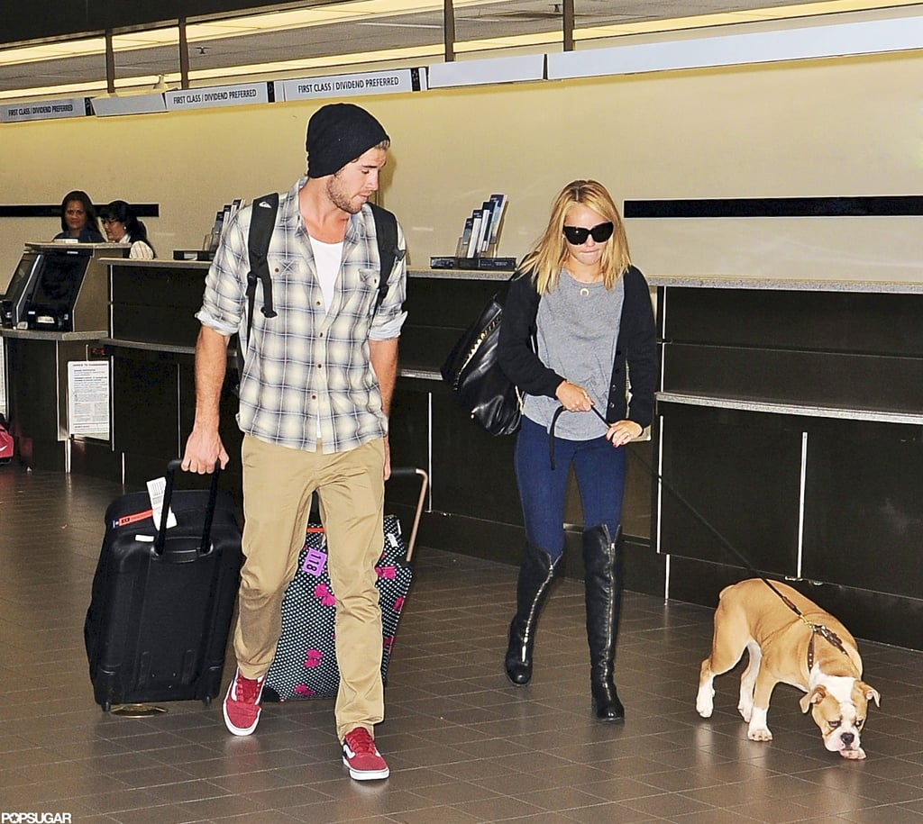 "Miley Cyrus and Liam Hemsworth made their way through LAX yesterday. Liam carried Miley's luggage while she held onto their dog Ziggy. The couple caught a flight to Philadelphia, where they touched down last night. Before their recent travels, Miley and Liam were spending time in LA during a break from Liam's work on Empire State. He and Miley went to Pilates class together and were also spotted skateboarding in their downtime.  Liam also has filming for Catching Fire on the horizon, and he recently shared Miley's take on the big-screen adaptation with Glamour. Miley is apparently ""team Katniss"" rather than taking a side between Liam's character Gale and Josh Hutcherson's Peeta. Liam and Josh may be welcoming new faces to the set when filming starts this Summer, after the latest round of Catching Fire casting news."