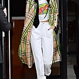 The model rocked an Anna Sui crop top with white jeans and a $2,600 Burberry plaid trench coat.