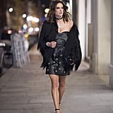 Alessandra Ambrosio wearing a Valentino dress, a Saint Laurent coat, Gianvito Rossi shoes, and Shay jewelry.