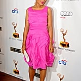 Kerry Washington popped in a major way in a hot pink Halston Heritage tiered dress, stark white Brian Atwood pumps, a matching Nancy Gonzalez clutch, and Joan Hornig earrings at the Primetime Emmy Award Nominees event in Hollywood.