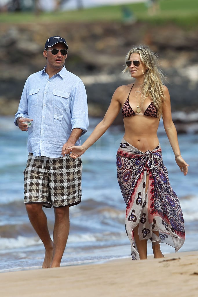 """Molly Sims wore a bikini and a colorful sarong as she and Scott Stuber took a walk on the beach in Maui today. Scott Stuber and Molly Sims married this weekend at a star-studded ceremony in Calistoga, CA before heading to Hawaii to honeymoon. Scott, a Hollywood producer, and Molly welcomed guests including Fergie and Josh Duhamel to their outdoor nuptials in California's wine country. Molly also tweeted a thank you to her best friend, who made the trek from Australia for her big day, and told her followers the wedding marked the """"BEST day of my entire life!"""" Molly and Scott looked every bit the happy couple as they held hands and beamed during their island getaway. Congrats to them both!"""