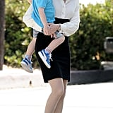 Elizabeth Banks was on set with her son, Felix, on Sunday and carried him around between takes.