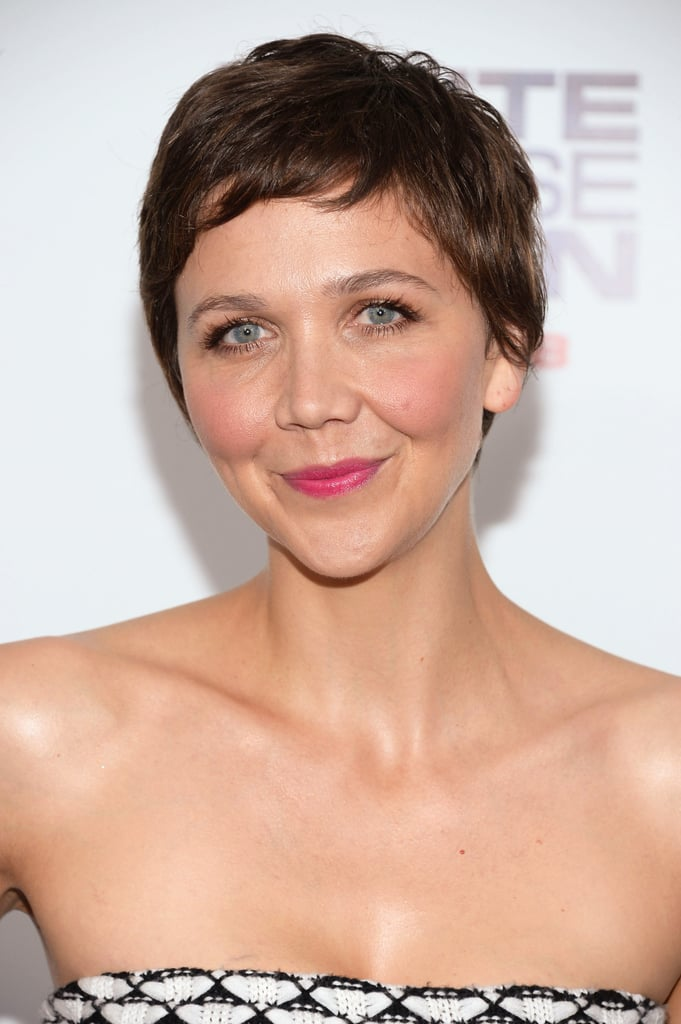 "Maggie Gyllenhaal attended the premiere of White House Down earlier this week, and makeup artist Molly R. Stern created her fresh look. ""I wanted her skin to be flushed and healthy with a pop of a lip and a whole lot of lashes,"" she said. To achieve this, Stern used Flower Beauty Lip Color in Sweet Peony ($7) on Maggie's lips and then added a burst of color by applying Flower Beauty Lip Color in Petunia Petals ($7) just in the center. ""For her lashes I layered By Terry Mascara in Black and Brown ($40 each),"" she said."