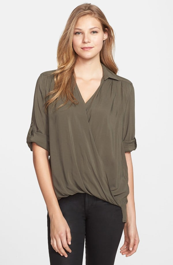 Like the essential button-down, only better — this Mac & Mia faux wrap high/low blouse ($48) has a more feminine twist.