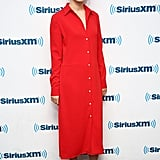 Wearing a red shirt dress with a pair of bejeweled heels.