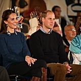She removed her coat inside to reveal a collared button-up and sweater — and a coordinating style moment with Prince William.