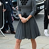 Kate completed her sophisticated look with black functional pumps.