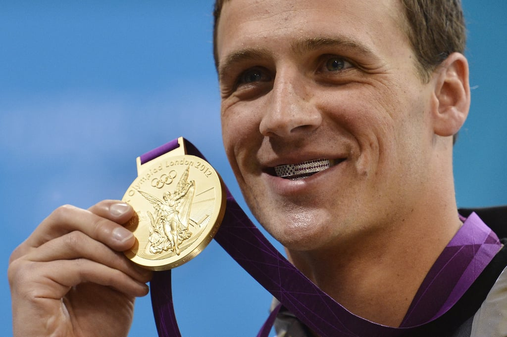 """Ryan flashed his American-flag grill and his gold medal. He's described it as """"a retainer filled with diamonds."""""""