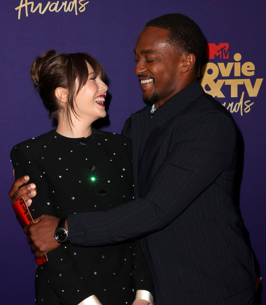 Anthony Mackie and Elizabeth Olsen brought their superhero talents to the MTV Movie and TV Awards. On May 16, the Avengers: Endgame costars hugged it after snagging their first wins of the evening. Anthony won the first award of the night for best hero for his role in The Falcon and the Winter Soldier, while Elizabeth won best performance in a show for her role in WandaVision. The two surprised each other backstage after receiving the very heavy golden popcorn trophies and it made for an adorable MCU reunion. Assemble, and check out the sweet moment between Anthony and Elizabeth ahead.      Related:                                                                                                           The MTV Movie & TV Awards Brought Out the Glam Minidresses and Jordan Sneakers
