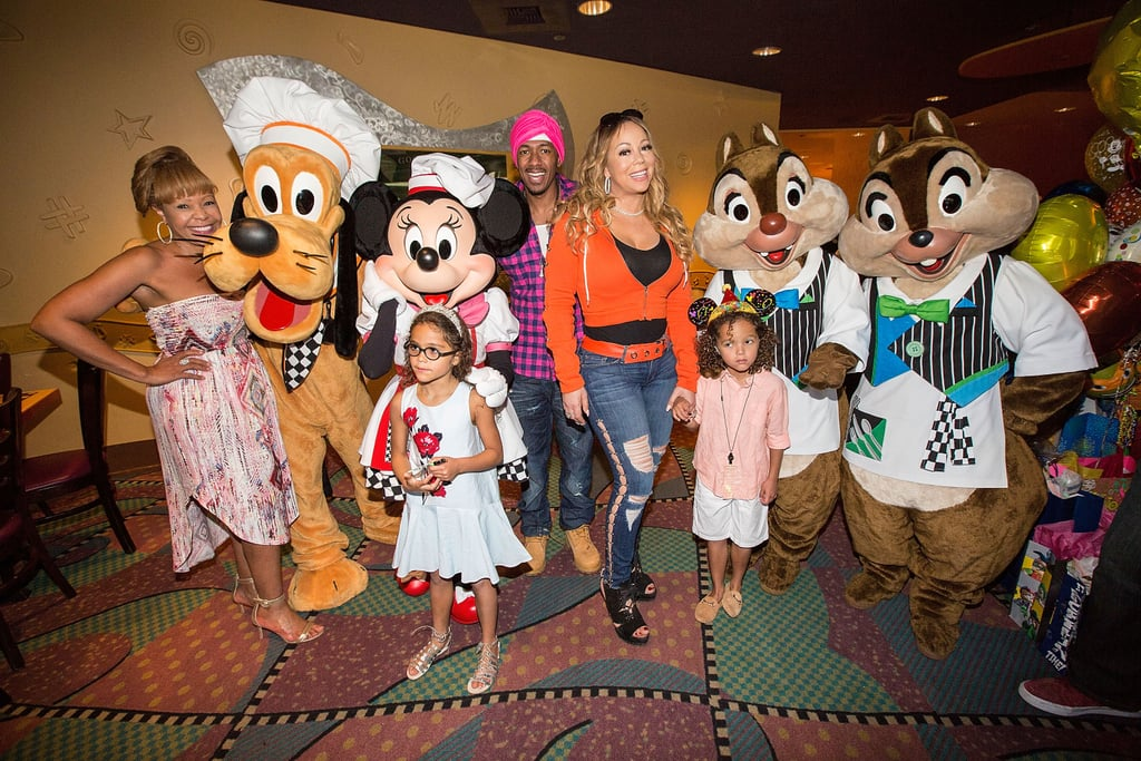 Mariah Carey isn't just a glamorous celebrity, she's also a glamorous mom. The singer pulled out all the stops when she celebrated her twins Moroccan and Monroe's sixth birthday at Disneyland alongside her ex-husband, Nick Cannon, on April 30. In addition to taking a ride on Space Mountain as a family, the twins also mingled with some Disney pals at Goofy's Kitchen as they munched on Minnie and Mickey Mouse-themed cakes and opened their presents. And the magical day certainly didn't come cheap either, as the former couple reportedly dropped five figures on the birthday bash. But it shouldn't come as a surprise that they would pick the happiest place on Earth to celebrate. Not only is it every kid's dream to ring in their birthday at Disneyland, but it's also where Mariah and Nick renewed their vows back in April 2013.