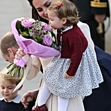 While Princess Charlotte took a moment to stop and smell the roses before boarding the plane.