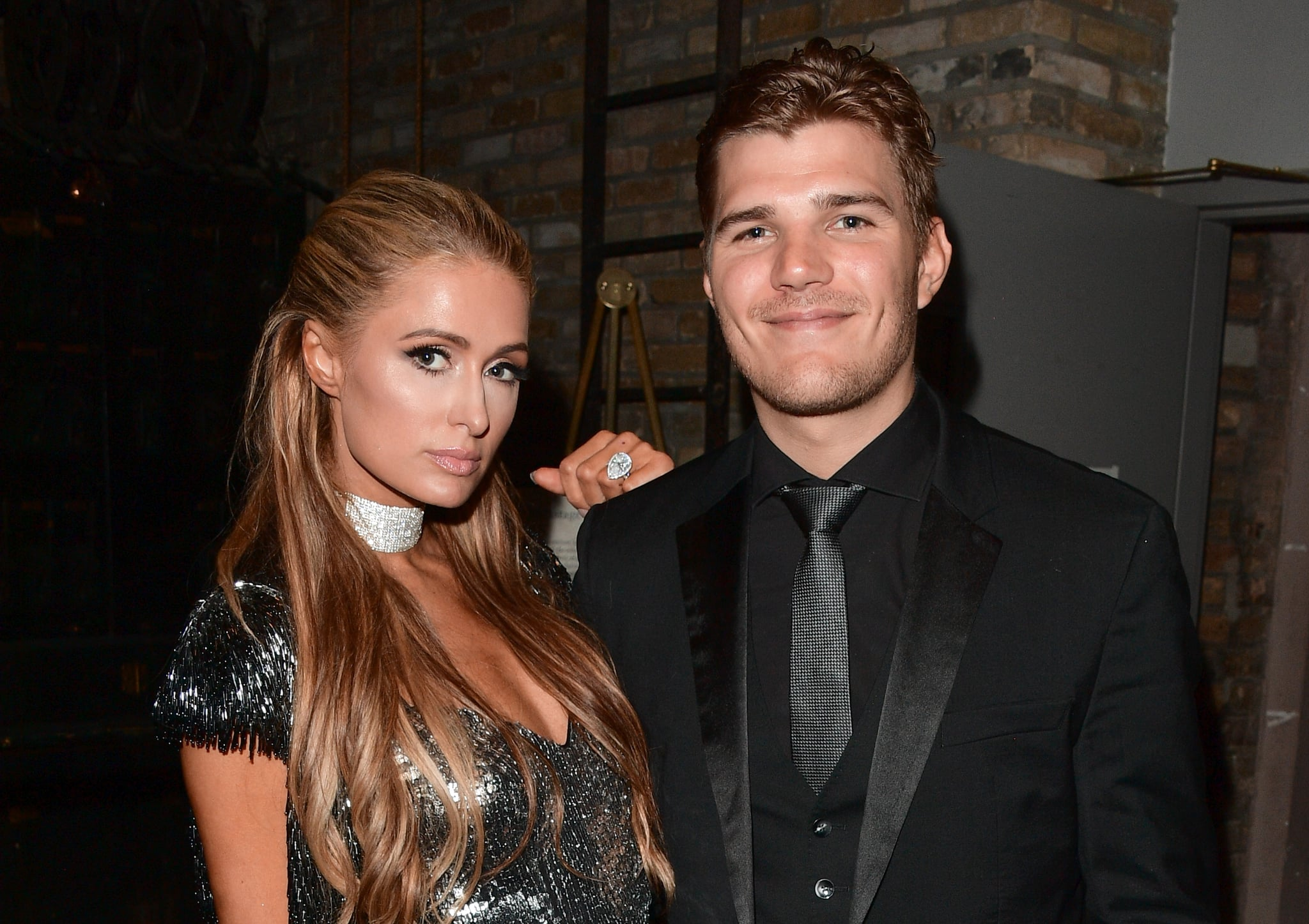 TORONTO, ON - SEPTEMBER 10: Paris Hilton (L) and Chris Zylka attend the