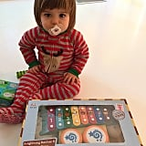Jaime King's son, James Newman, looked impressed with his new instrument set.