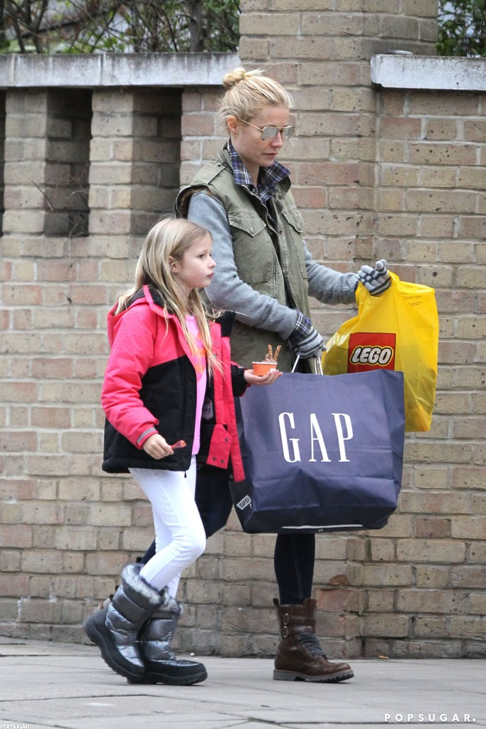 Gwyneth Paltrow carried a GAP bag as she shopped around London with Apple Martin.