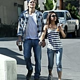 Ashton Kutcher and Mila Kunis carried beverages while out together.