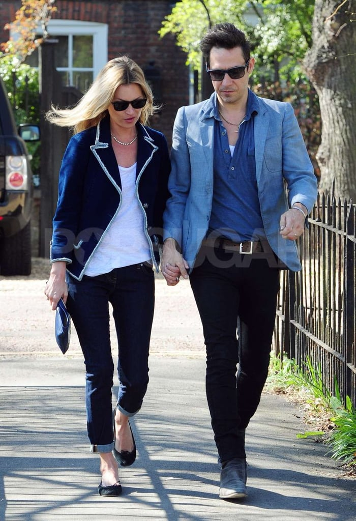 Kate Moss and Jamie Hince take a stroll hand in hand near their home in London.