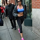 Padma Lakshmi showing off her torso as she heads for a workout.