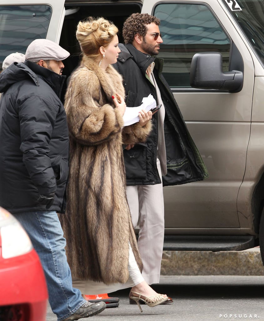 Jennifer Lawrence wore an updo on a Boston set with a curly-haired Bradley Cooper.