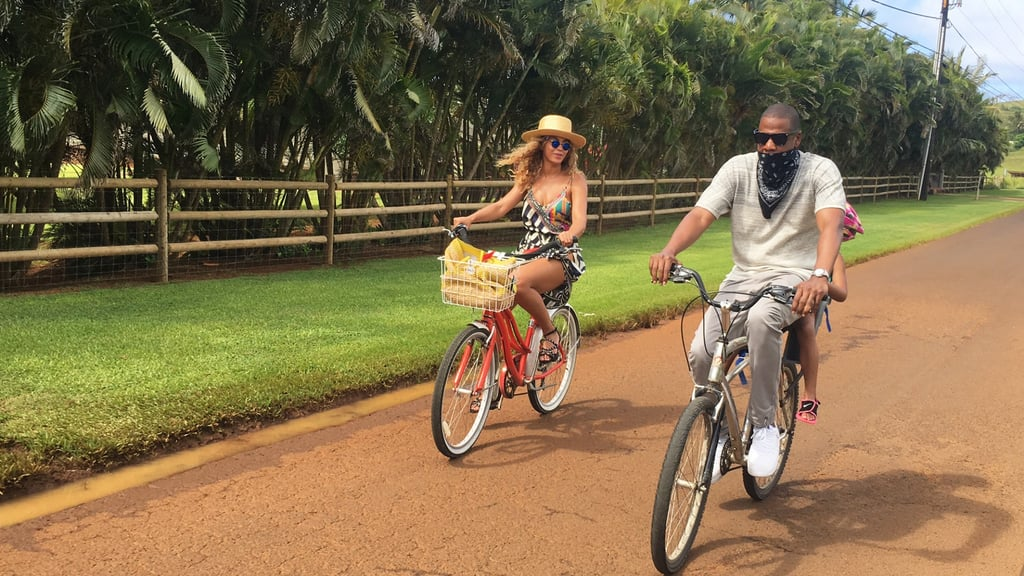"""Following a week of sweet date nights, Beyoncé and Jay Z took a break from their busy schedules and escaped to Hawaii for the perfect Summer vacation. On Monday, the duo put their love on display on the beach as they snapped cute selfies and took in the beautiful ocean view together. At one point, Jay Z even leaned in to kiss Beyoncé, who donned a colorful swimsuit with a lemon crown and matching necklace, making an obvious reference to her controversial Lemonade album. Throughout the week, Beyoncé has been taking to her website to upload a slew of gorgeous photos fit for a scrapbook, featuring her husband and adorable daughter, Blue Ivy Carter. June is already shaping up to be a big month for the """"Sorry"""" singer. Shortly after making a surprise appearance at the CFDA Fashion Awards and bringing her family to tears with an emotional speech, Beyoncé returned to her tour, where she very graciously sneezed in front of an entire stadium and re-created daughter Blue's funny finger wag moment. She also dedicated her song """"Halo"""" to the Orlando shooting victims during one of her stops in Detroit last week. See more of the couple's dreamy getaway, then get inspired by these Beyoncé quotes."""
