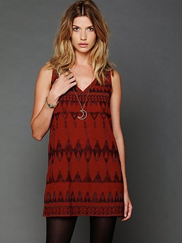 While it's cold outside, layer this Free People Frances shift dress ($100, originally $168) with a fitted long-sleeved sweater, cozy tights, and ankle boots for a retro '70s feel.