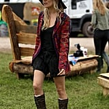 We can't help but imagine dressing for Glastonbury is a no-brainer for Sienna Miller, whose personal style manifests itself here in a floppy hat, slouchy boots, and bohemian topper.