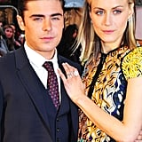 Zac Efron and Taylor Schilling got close at the premiere of The Lucky One in London.