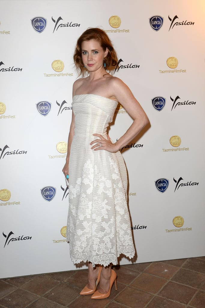 Amy Adams accentuated her white strapless lace dress with orange Rupert Sanderson pumps and turquoise earrings at the Taormina Film Fest in Italy.