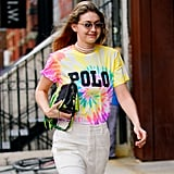 Looking to dress your favourite t-shirt? Look to Gigi Hadid. The supermodel styled her pearl choker necklace with a tie-dye Polo shirt and Prada bag.