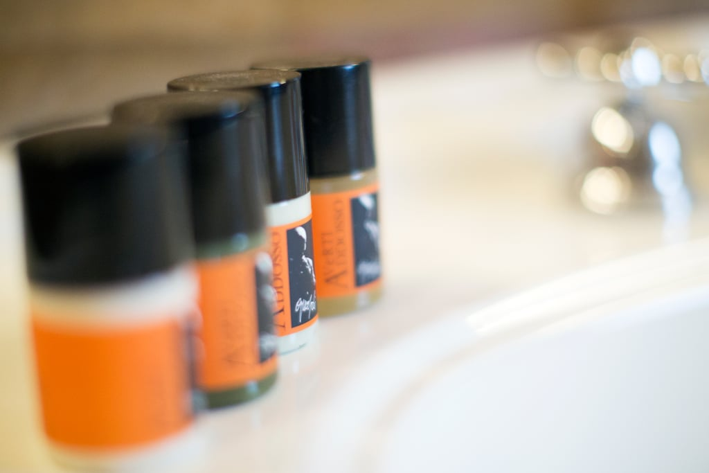 Stashing all the shampoo, conditioner, and bars of soap possible to bring back with you.