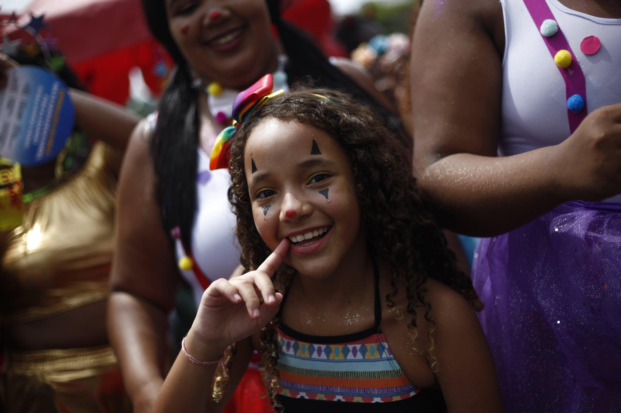 RIO DE JANEIRO, BRAZIL - FEBRUARY 16: A kid smiles at Bloco da Preta in downtown Rio on February 16, 2020 in Rio de Janeiro, Brazil. (Photo by Wagner Meier/Getty Images)