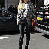 Joanna Hillman played it slick with a pair of slim trousers, then styled them up with a classic houndstooth blazer.