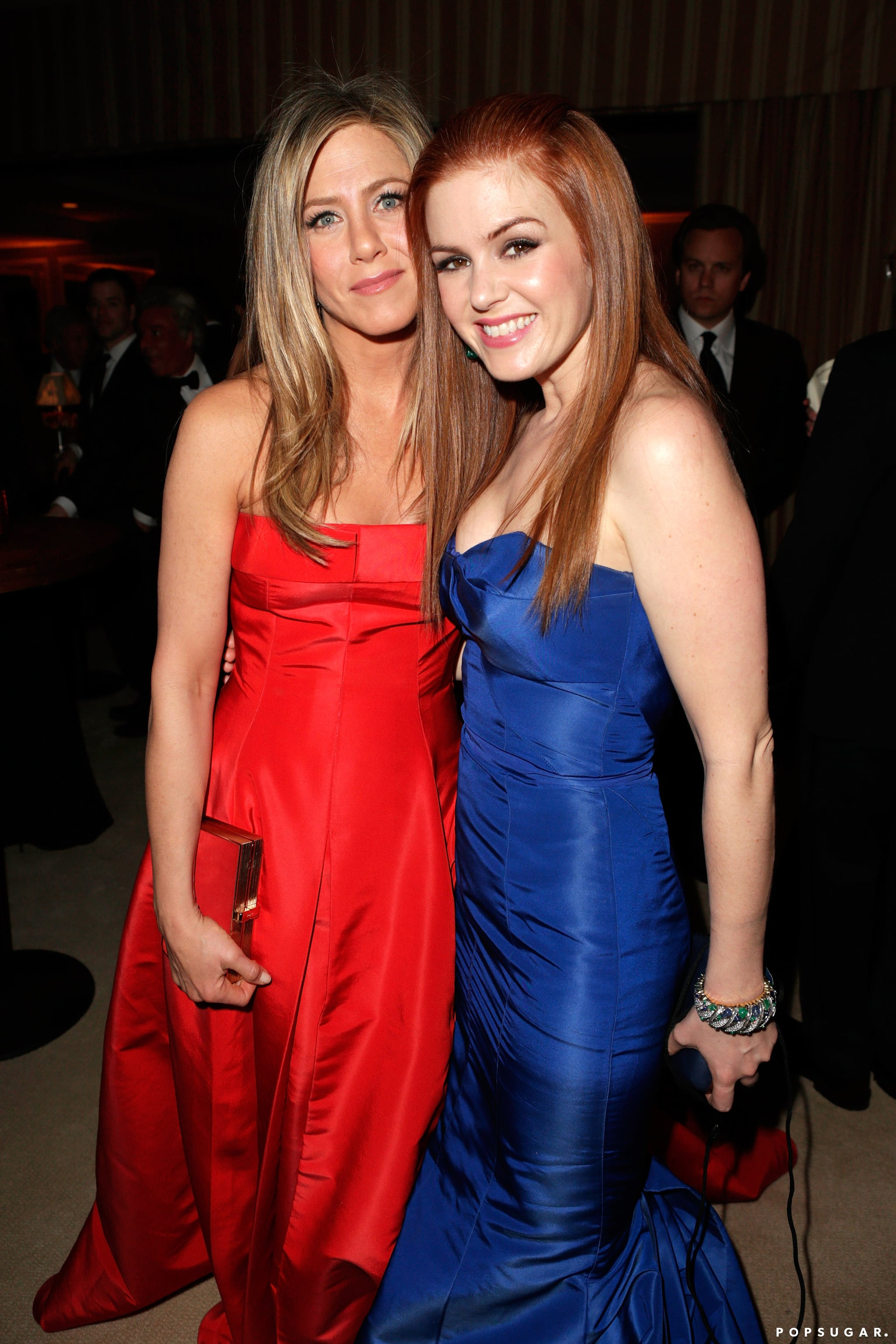 Jennifer Aniston posed with Isla Fisher at the Vanity Fair Oscars afterparty in Hollywood on Sunday night.